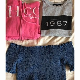 Olika överdelar! Hoodie med dragkedja: Hollister, storlek XS💕 T-Shirt : Vero Moda, storlek XS🤍 Off shoulder topp : Pull&Bear, croppad, storlek M💙Enskilt för 60kr, alla 3 för 150!