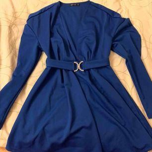Ny klänning ifrån Nelly som är uringad framtill.