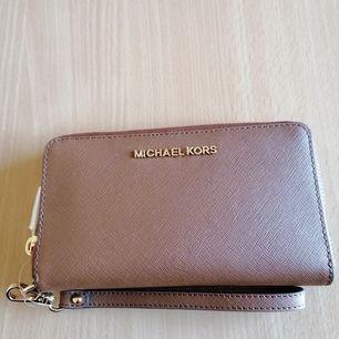 Oanvänd, Michael kors plånbok