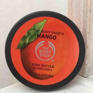bodybutter med doft av Mango från the body shop. ALDRIG använd, inte ens testad, helt ny. säljer pga kommer inte till användning. frakt tillkommer