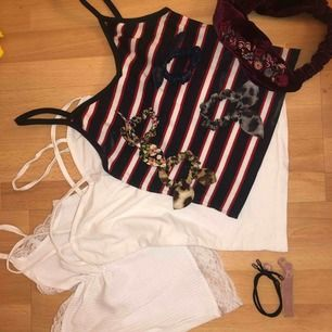 Paket! Innehåller: tre tröjor, ett hårband, 4 hårsnoddar med rosetter, 2 söta övriga hårsnoddar