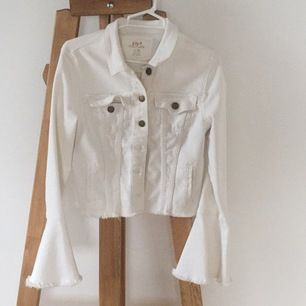 Cool white jeans jacket, good condition, flare arms. Sits tight.