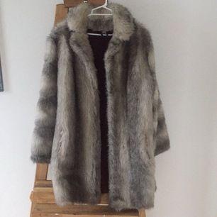 Used but adorable vintage fake fur coat