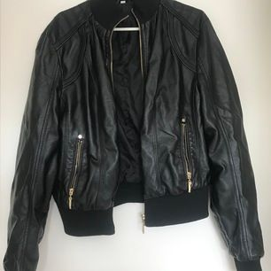 Fake leather jacket. Small fit with gold zipper