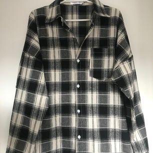 Checkered black and white shirt