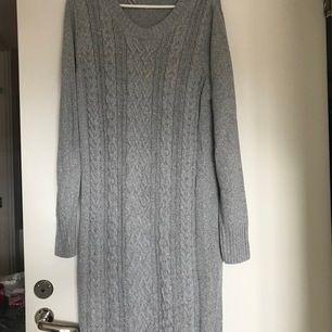 Knitted winter grey dress