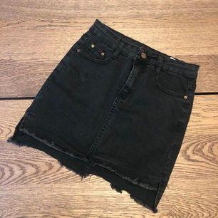 Jeans kjol i storlek XS.