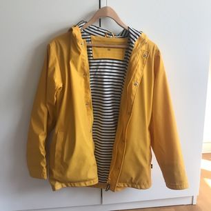Yellow rain jacket bought in France. Size XS but it is a bit oversized