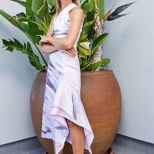 RARE H&m conscious exclusive dress made from sustainable materials, including BIONIC® - a polyester made of plastics recycled from shoreline waste. It is a premium collection made for special occasions.  Calf-length dress in sturdy, bonded, patterned fabr