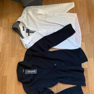 En svart och en vit blus/skjorta som kan användas till vad som helst, kjol, jeans mm! Frakt 68kr, eller mötas upp🌸