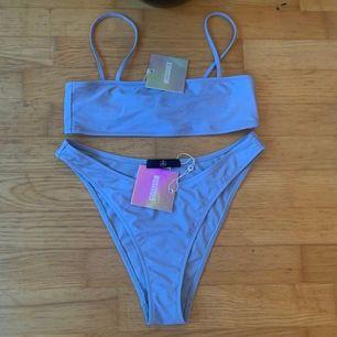Helt ny babyblå bikini från Missguided, hög i midjan, cheeky cut, köparen står för frakt (63kr) toppen strl 38, botten strl 40