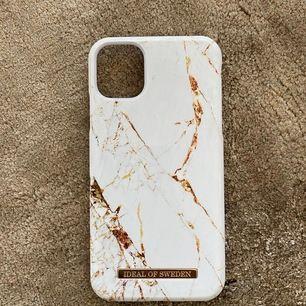 Mobilskal från Ideal of Sweden till Iphone11. Marmor-mönster i vit/guld 🕊 Använd endast ett par månader. Hämtas i Sundbyberg, annars står köparen för frakt!