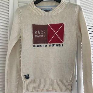Stickad tröja från Race Marine. Säljes för 30kr. Stickad. Från MQ. Står storlek 36. I bra skick. Hämtas i Skarpnäck eller skickas för 42kr.