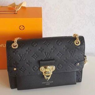 Louis Vuitton väska i 100% äkta läder ingår box kvittot påse