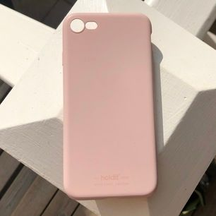 ett jättefint babyrosa mobilskal från holdit av hårt silicon. passar till iphone 7. nypris 149 kr.